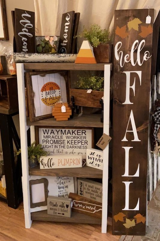 A collection of handmade wooden signs.