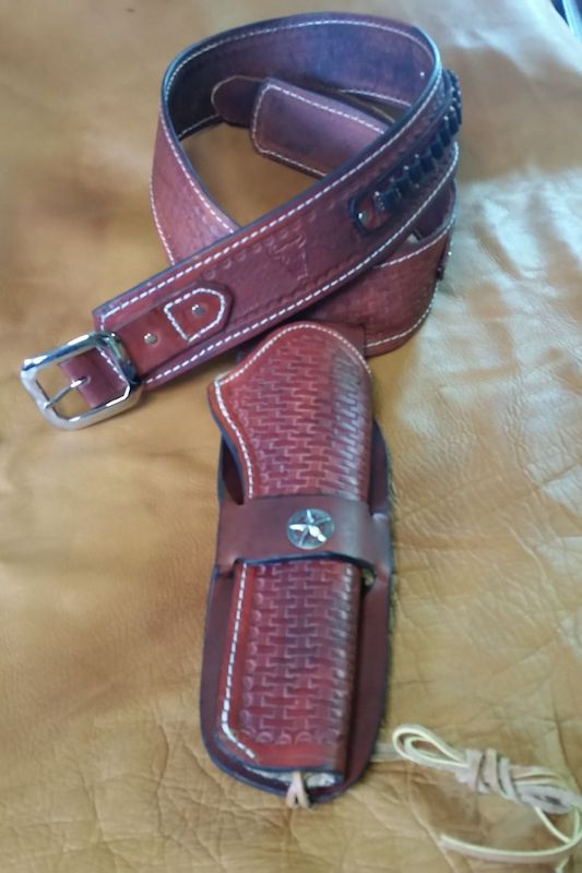 A leather belt and gun holster handmade by local leathworker