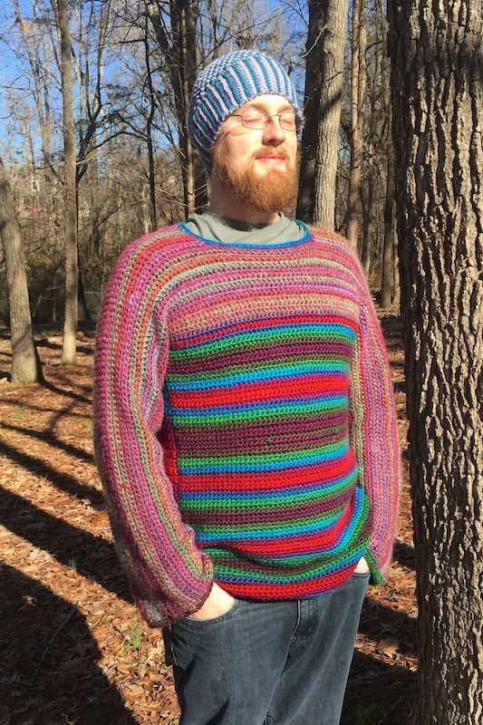A photo of someone wearing a knit beanie and sweater from Manic Knits.