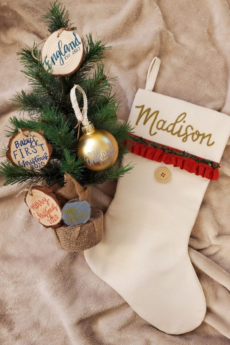 A Christmas stocking and wooden ornaments made by Mad's Markings