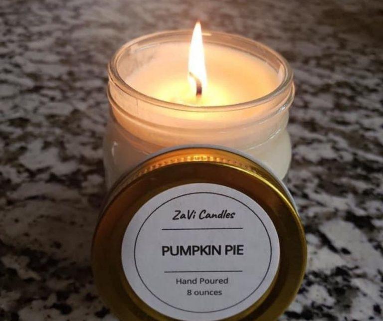 A pumpkin-pir scented candle in a glass mason jar